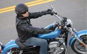 Motorcycle rider with half helmet