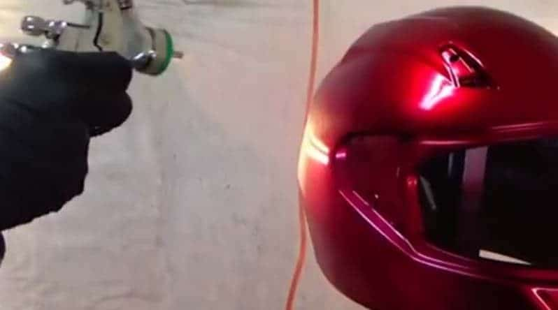 spray painting a helmet