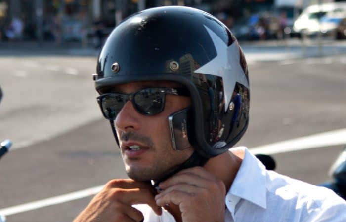 Open face helmet on a rider