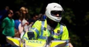 Policeman on bike with helmet on