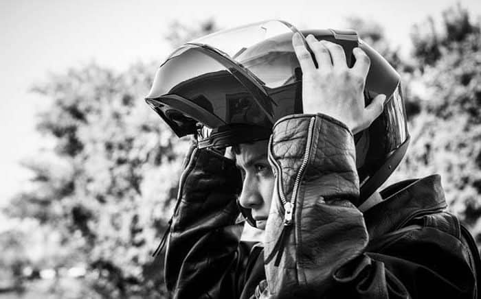 motorcyclist wearing a flip face helmet